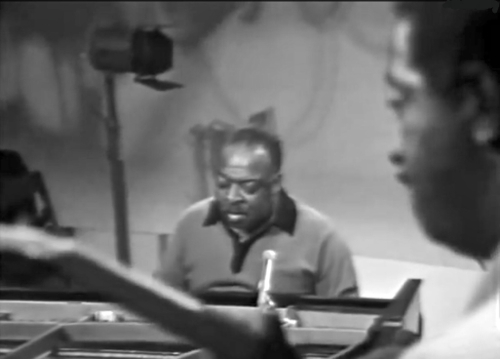 Count Basie at the piano in 1964