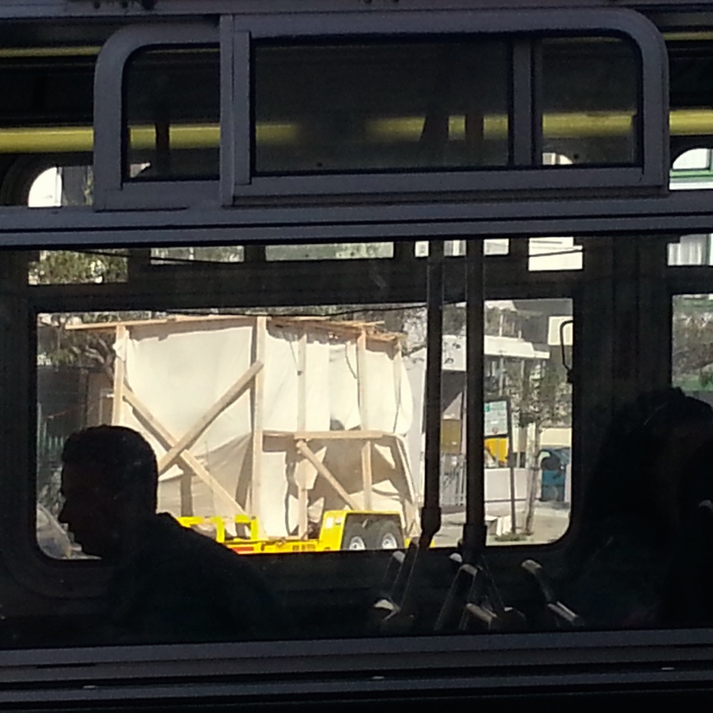 Sukkah through a bus window